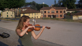 Summer Research Fellowships music performance abroad student playing violin