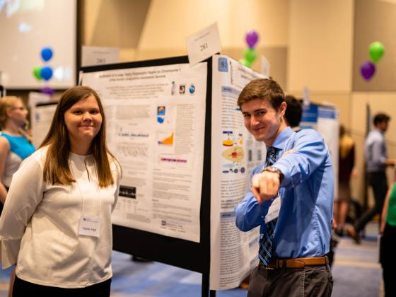 Joseph Walden and research partner presenting at Showcase of Undergraduate Research