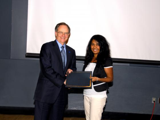 President Todd awarding undergraduate research student